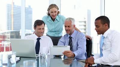 stock-footage-group-of-business-people-using-laptop-and-tablet-computer-during-a-meeting
